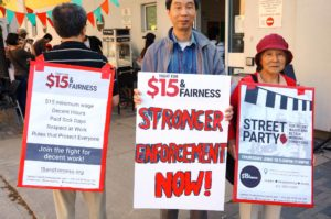 Workers' Action Centre members at 2015 Street Party demanding Stronger Enforcement Now