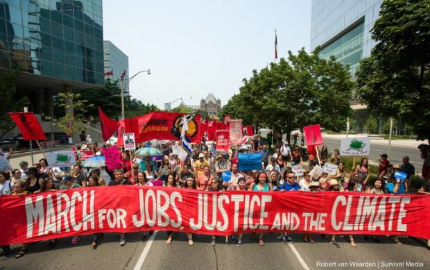 Workers rally for a $15 minimum wage at the March for Jobs, Justice & the Climate on July 5.