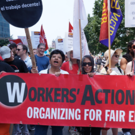 Workers' Action Centre banner at rally