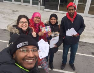Muslim Workers Network handing out flyers and postcards